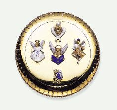AN AMUSING ENAMEL AND GOLD POWDER COMPACT, BY PAUL FLATO