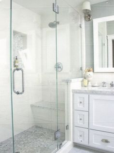 glass shower enclosure on wall b/t shower and vanity