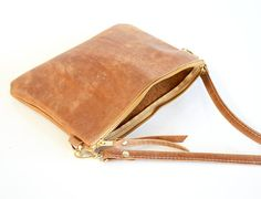 Small Leather crossbody bag with a simple minimalist design. Beautiful soft cowhide leather purse great for gift giving. *** This bag is hand made to order - please allow up to 3 weeks production time*** Please note that standard shipping on this item is the cheapest rate possible but