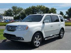 2014 Honda Pilot Touring White. When we have another child we need a car like this.