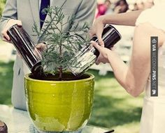 Cool take on unity candle/sand pouring: taking soil from the parents' homes and planting a tree with it. ♥