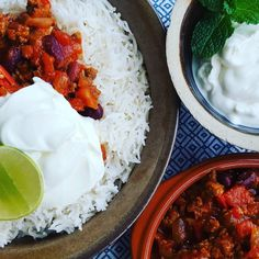 Spicy homemade chili con carne with rice and Greek yoghurt