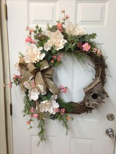 Grapevine wreath using magnolia blossoms, apple blossoms, Ivy, a bird, and birdhouse with a burlap Mississippi print bow. March 2016 by shelley Diy Spring Wreath, Summer Door Wreaths, Easter Wreaths, Holiday Wreaths, Wreath Crafts, Diy Wreath, Grapevine Wreath, Wreath Ideas, Wreath Making