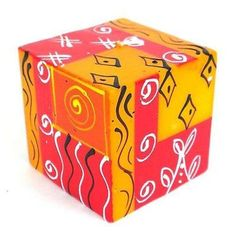 Hand-Painted Cube Candle - Zahabu Design Handmade and Fair Trade. Red and Orange color. This colorful candle features a cube shape, which is hand-painted by artisans in South Africa. Each candle is inches square. Living Room Candles, Bedroom Candles, Romantic Candles, Handmade Candles, Decor Crafts, Candlesticks, Candle Holders, Artisan, Hand Painted