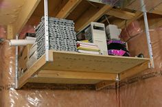 A simple, affordable, do-it-yourself, overhead garage storage loft building kit. Each Loft-Maker kit includes the mounting hardware to help you build a sturdy wooden loft. All you need to supply is the wood! http://organizedgarage.ca/garage-overhead-storage/overhead-storage-4ftx4ft-loftmaker-garage