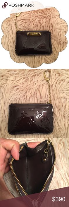 NO OFFERS Authentic Louis Vuitton Vernis Key Pouch 100% Authentic Louis Vuitton : Date Code SN2153 : Vernis Leather in the color Amarante : No tears or stains (leather pull has come off, but still has the metal tab to zip) I will include the leather pull : Original Price $390 : No dustbag : NO BUNDLES NO TRADES : THIS IS MY LOWEST PRICE ON THIS ITEM Louis Vuitton Bags Wallets