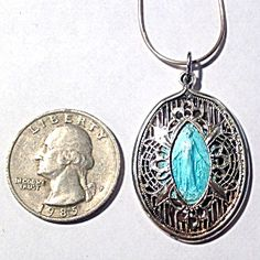 $199 ON SALE! Antique Sterling Filigree Guilloche Enamel Miraculous Medal Necklace (Image1)Gorgeous large size, Antique sterling silver filigree pendant featuring a blue enamel Miraculous medal. The blessed mother Virgin Mary as Our Lady of Grace and Miracles. The sterling chain is 18 inches and appears newer.