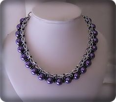 Necklace made of aluminium chain, and purple round beads