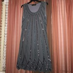 AngelEye London Sparkly Dress Dress worn one time! In great condition. All beads in tact. Bought at a boutique shop. Wears a little past the knee. Angeleye London Dresses