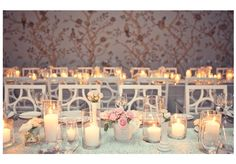 Lots of candles! Gray linens and milk glass
