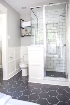 We used large, hexagonal flooring throughout the whole bathroom. I love the way it paired with the classic white subway tile we used in the shower. remodel A Master Bathroom Renovation Bathroom Grey, Bathroom Renos, Bathroom Remodeling, Remodeling Ideas, Remodel Bathroom, Bathroom Vanities, Bathroom Cabinets, Budget Bathroom, Bathroom Flooring