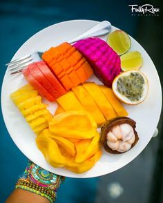 BEAUTIFUL assortment of tropical fruits: pineapple watermelon papaya dragon fruit mango jackfruit mangosteen and passion fruit...with a squirt of lime juice! Perfection.  Bali VLOG link in bio!  Subscribe: http://www.youtube.com/fullyrawkristina  Picture taken at Villa Ramadéwa @elitehavens