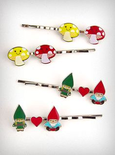 This set includes 2 different pairs of hairpins - A set of Gnomes & Hearts, and a set of Happy Mushrooms. Each pair features colored enamel against a shiny nickel plated background.