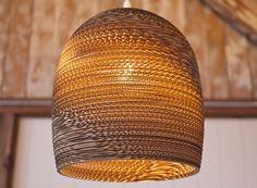 Graypants Scrap Cardboard Lamps    Pendant lamps, laser-cut from repurposed cardboard boxes. Beautiful!