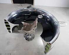 This reception desk has been made from the engine intake of a Boeing 737. It costs £20,000. The firm has also created other circular office ...