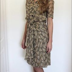 """Vintage DVF 80s Silk Wrap Dress Vintage DVF wrap dress. Size 4 but fits like XS. In excellent condition. Slip included. Length:38"""" Across at bust: 17 ½"""" Across at waist: 15 ¾"""" Across at hips: 17 ½"""" Shoulder to shoulder: 14 ¾"""" Sleeve length: 9 ½"""" Tag size: 4 Fits like: XS/S Diane von Furstenberg Dresses Midi"""