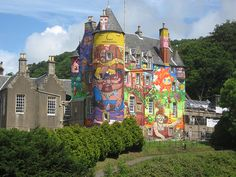 "not really street, but a great installlation... ""castle"" is in Scotland and due for some exterior resurfacing, so they let the artist have at it first!"