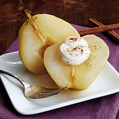 Spiced Poached Pears | This elegant but yummy sweet treat is a slow cooker sensation that is sure to be one of your all-time favorite desserts. Top with crème fraiche and cinnamon, if desired.