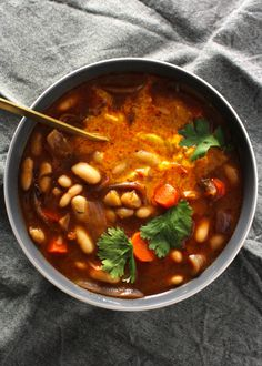 Cozy up on a cold night with a wary and spicy bowl of this Thai White Bean Stew with Turmeric Yogurt, which is not only a one pot meal, but easy to prepare.