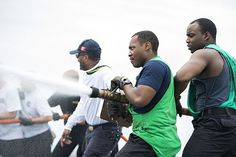 Aviation Boatswain's Mate (Equipment) 3rd Class C. A. Brooks, left, and Airman D. P. White compete in the hose-handling event during the Flight Deck Olympics aboard the aircraft carrier USS Harry S. Truman (CVN 75).