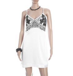 109 F - STRAPPY SATIN DRESS  A lazy white strappy summer dress with a heavily embroidered and fitted bodice that skims and flirts is perfect for those who have it and want to flaunt it. Go adventurous with white gladiators or strappy sandals.
