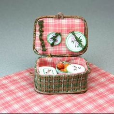 A Miniature Dolls House Picnic Basket with a Fitted Lining.