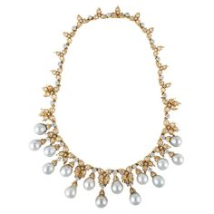 BUCCELLATI Diamond and Cultured Pearl Necklace,This spectacular necklace consists of 11 carats of rose-cut and round brilliant-cut diamonds and 15 light gray cultured pearls measuring 10 millimeters by 12 millimeters. It is set in 18 karat yellow gold and is signed Buccellati. Circa 1980