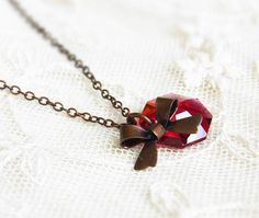Ruby and Bow Necklace . swarovski crystal with antiqued bronze bow by CocoroJewelry on Etsy