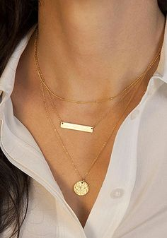 Keep it simple, keep it chic. This delicate triple-layered necklace, featuring a matte rectangle pendant and a circle chain pendant, is a great every-day piece to wear with boat neck tops or V-neck tees.