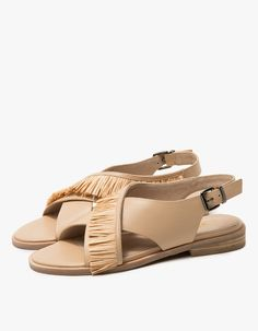 Slingback sandal from Sol Sana in Natural. Crossover vamp with raffia detailing. Adjustable buckle closure at back. Pewter-tone hardware. Small stacked heel.   • Leather upper • Leather lining • Synthetic sole • Women's sizes listed