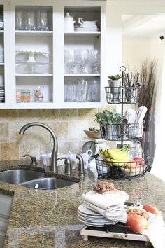 Painted Kitchen Cabinets- DIY painted kitchen cabinets- one year later- white kitchen- open shelves in a kitchen- open shelving ideas- kitchen shelves- 3-tier kitchen storage