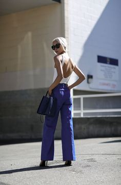 Vanessa Hong of The Haute Pursuit makes the '70s trend her own in blue H&M wide leg pants. | H&M OOTD
