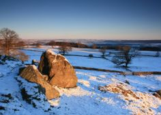 Robin Hoods Stride looks out across the Wye Valley in the Peak District. As the sun rose at dawn on Christmas Day the...