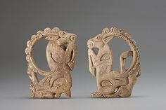 Belt buckle in the form of carved mountain goats with intertwined hinds  Pazyryk culture in the Altai.6th-3rd century B.C.  Horn  The Siberian collection of Peter the Great  State Hermitage Museum