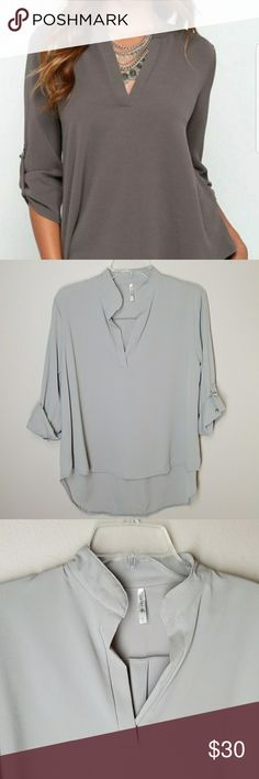"""Lucky Blouse Simply Sophisticated in this blouse.  Light gray see other pics for true gray, not the first pic Armpit-Armpit 22"""" 100% polyester  Roll up sleeves see pic 4 , u can also wear the sleeves down. Lucky  Tops Blouses"""