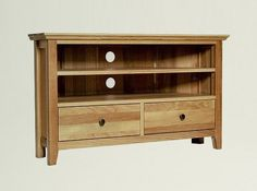 Hereford Rustic Oak Corner TV Unit - The Hereford Rustic Oak Corner TV Unit features one shelf at the top which creates two useful spaces for a DVD player or Sky Box. The shelf is adjustable and the unit also has two drawers below with integrated runners as well as dovetailed joints ensuring they open and close with ease.