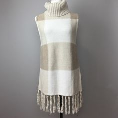 Adam Lippes Knit Tunic XS Such a beautiful knit piece with high turtle neck, side vents and fringed bottom. From the Made for Target line from Adam Lippes. Size XS. Can also fit a Small. 100% cotton. Adam Tops Tunics