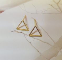 Check out this item in my Etsy shop https://www.etsy.com/il-en/listing/234856425/triangle-stud-earrings-gold-triangle