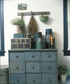 Drawers, pantry boxes, peg rack, basket, and drieds.