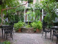 Classic fountain planted heavily in French Quarter courtyard
