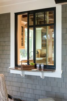 Kitchen exterior pass-through window. Use same counter materials inside and out for continuity.   by Solaris Inc.
