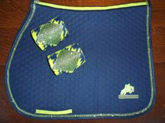 Custom made saddle pad navy with lime green bling trim and accents and matching polo wraps.  $65 Email orders to thebarncloset@cox.net