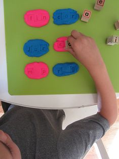 Fill in the blank spelling for kids. Rolling and squishing playdough develops hand muscles and grasping small stamps develops fine motor skills. Oh, and this activity works on CVC spelling words!