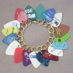 okay, this is cool. it'd be even cooler if you could unclip the guitar picks and use them. gotta figure out how to do that
