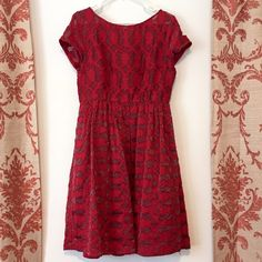 """ANTHROPOLOGIE red lace dress  Beautiful shimmering red lace dress with pockets! Bought from another Posher but it does quite fit my bust. Sorry to see this beauty go. Moulinette Soeurs size 10. Waist 15"""", bust 18"""", length 39"""".   Will consider a reasonable offer. It never hurts to ask, right? Anthropologie Dresses"""