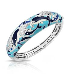 Delfino Collection; Blue Bangle Bracelet; Hand-painted dolphins in ocean blue and cream Italian enamels with white stones set into rhodium-plated, nickel allergy-free, 925 sterling silver.