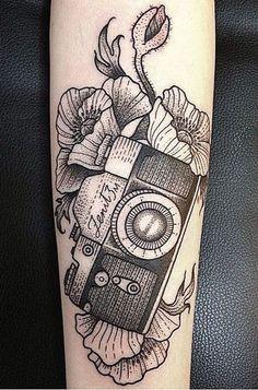 Black work 35mm film SLR camera tattoo. Artist unknown