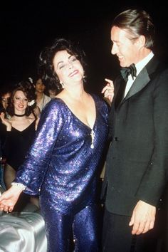 Elizabeth Taylor & Halston celebrate her birthday at Studio 54