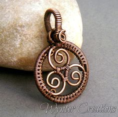 """[](http://www.knowth.com/newgrange/tri-spiral.jpg)If ever you look up """"Celtic symbols,"""" along with the shamrock and the [Celtic cross](http://wyntercreations.indiemade.com/product/celtic-cross-wire-wrapped-pendant-copper-and-amethyst?tid=1), one of the most common images you'll see is three spirals joined together."""