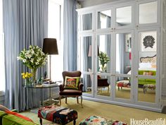 In a New York loft that lacked closet space, designer Steven Sclaroff added a mirrored wardrobe.